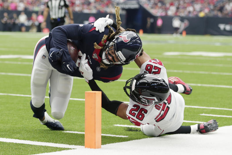Houston Texans wide receiver Will Fuller, left, is hit by Atlanta Falcons cornerback Isaiah Oliver after a catch during the second half of an NFL football game Sunday, Oct. 6, 2019, in Houston. (AP Photo/Michael Wyke)