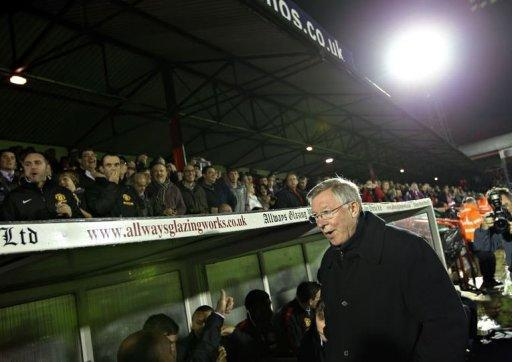 Manchester United's manager Alex Ferguson (R) waits beside the dugout ahead of the Carling Cup fourth round football match between Aldershot Town and Manchester United at The Recreation Ground in Aldershot. United won 3-0