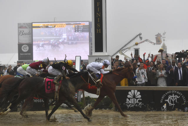 Justify with Mike Smith atop wins the 143rd Preakness Stakes horse race at Pimlico race track. (AP)