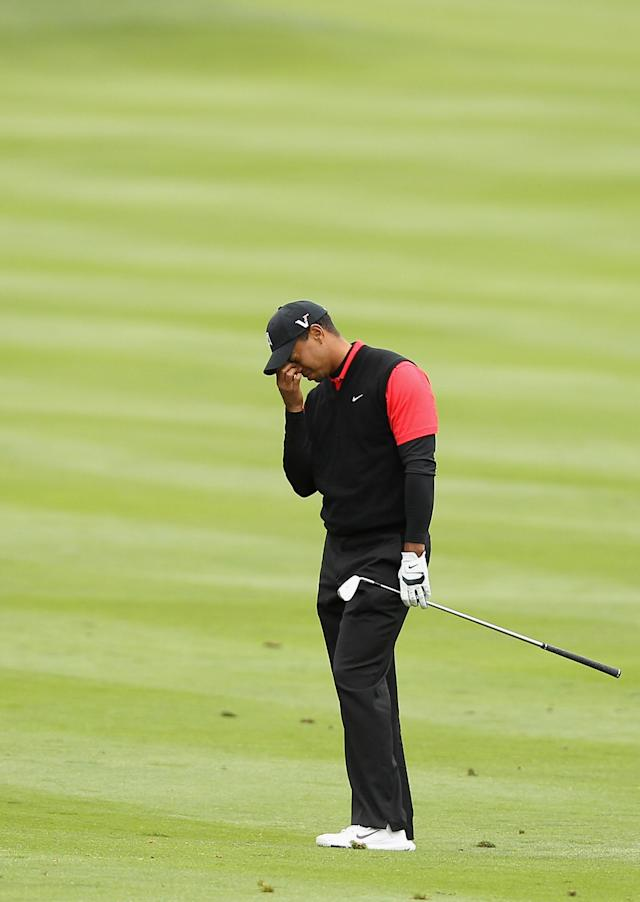 PEBBLE BEACH, CA - FEBRUARY 12: Tiger Woods reacts after hitting his second shot on the 14th hole during the final round of the AT&T Pebble Beach National Pro-Am at Pebble Beach Golf Links on February 12, 2012 in Pebble Beach, California. (Photo by Ezra Shaw/Getty Images)