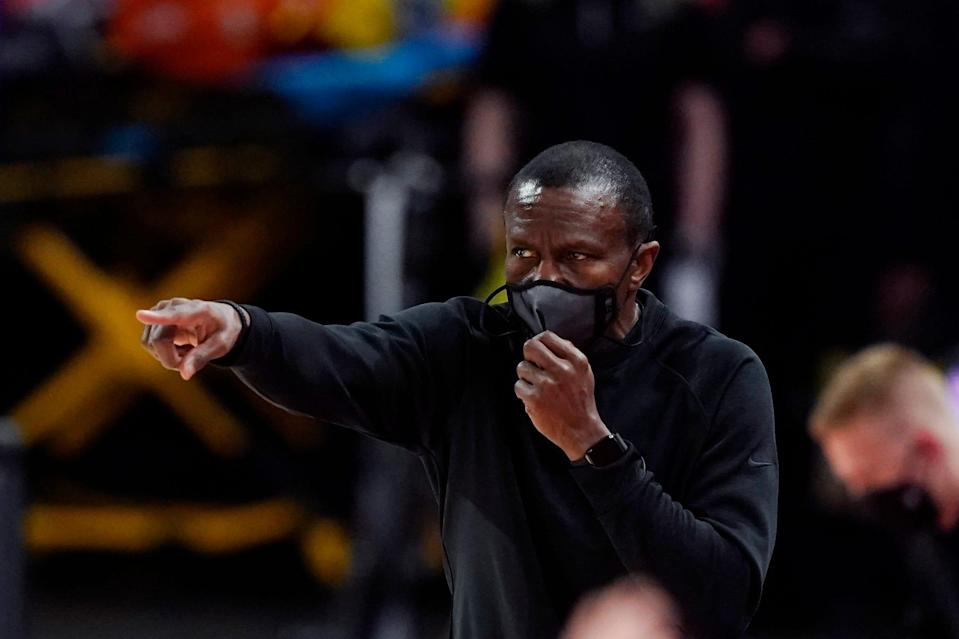 Detroit Pistons head coach Dwane Casey directs from the sideline during the first half of an NBA basketball game against the Chicago Bulls, Sunday, May 9, 2021.