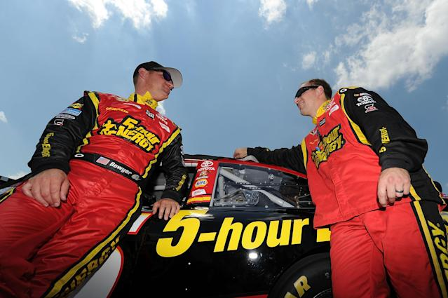 LONG POND, PA - JUNE 10: Clint Bowyer,(L) driver of the #15 5-hour Energy Toyota, talks with a crew member on the grid before the start of the NASCAR Sprint Cup Series Pocono 400 presented by #NASCAR at Pocono Raceway on June 10, 2012 in Long Pond, Pennsylvania. (Photo by Drew Hallowell/Getty Images)
