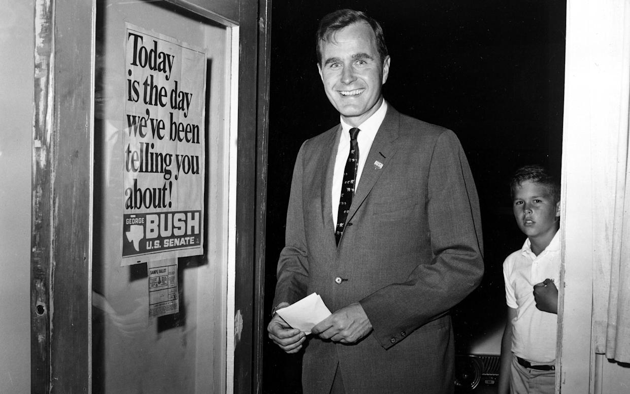 George Bush, then a Republican candidate for the Senate, arriving at his headquarters in Houston, June 1964. (Photo: AP)