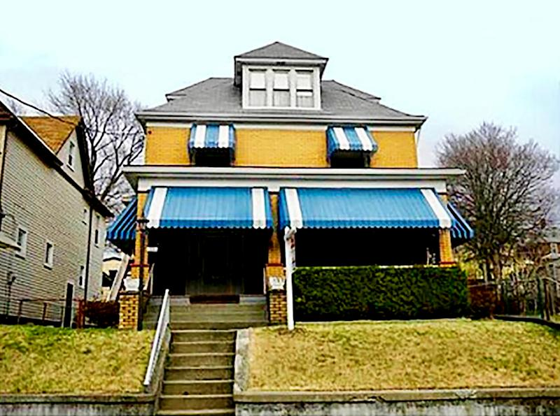 Front of yellow house with blue accents