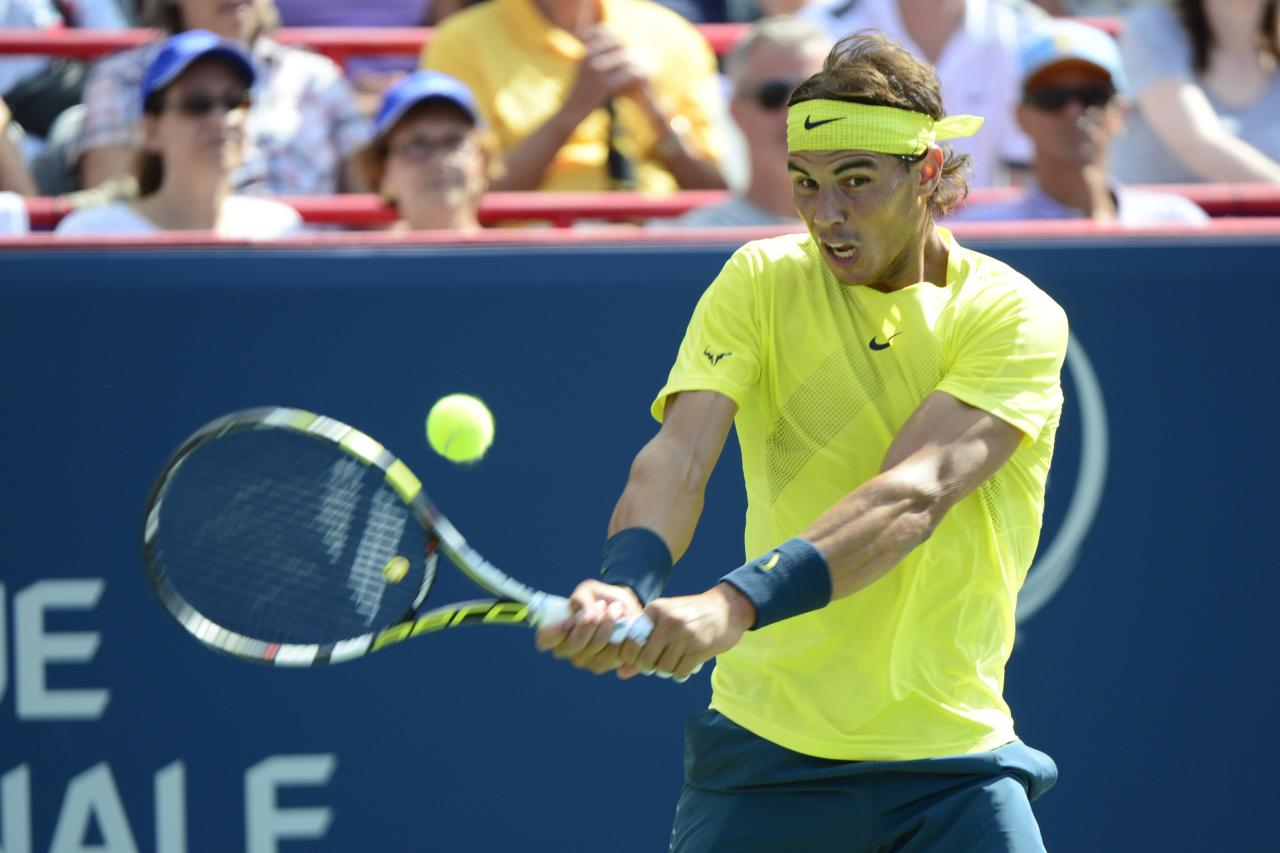 Rafael Nadal, of Spain, returns a shot to Milos Raonic, of Canada, during men's Rogers Cup tennis tournament final action in Montreal, Sunday, Aug. 11, 2013. (AP Photo/The Canadian Press, Paul Chiasson)