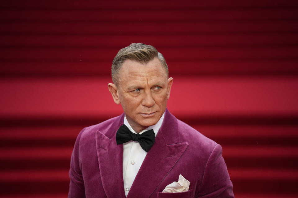Daniel Craig poses for photographers upon arrival for the World premiere of the new film from the James Bond franchise 'No Time To Die', in London Tuesday, Sept. 28, 2021. (AP Photo/Matt Dunham)