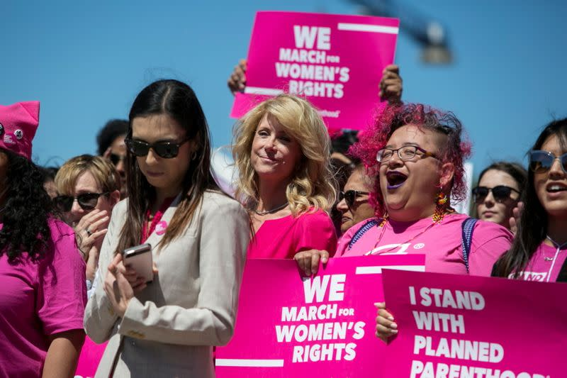 FILE PHOTO: Former Texas State Senator Wendy Davis (C), attends a Planned Parenthood rally outside the State Capitol in Austin