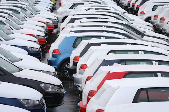 File photo dated 28/02/14 of new cars at a compound in Sheerness, Kent as nearly half of drivers in the UK spend more disposable income on their car than anything else, according to a survey. PRESS ASSOCIATION Photo. Issue date: Thursday April 10, 2014. Spending on cars (47%) easily outweighs the amount spent on holidays (21%) and socialising with friends (13%), the poll from Halfords Autocentres showed. But the survey also found that 10% of drivers were cutting back on car maintenance to save money. See PA story TRANSPORT Drivers. Photo credit should read: Gareth Fuller/PA Wire