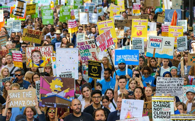 Hundreds of thousands of young people worldwide join marches while holding placards during the protest in London. | SOPA Images/Getty Images