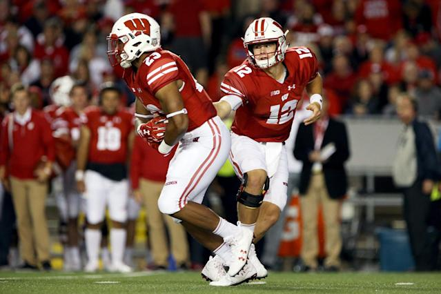 "MADISON, WI – SEPTEMBER 01: <a class=""link rapid-noclick-resp"" href=""/ncaaf/players/251340/"" data-ylk=""slk:Alex Hornibrook"">Alex Hornibrook</a> #12 of the <a class=""link rapid-noclick-resp"" href=""/ncaab/teams/wbg/"" data-ylk=""slk:Wisconsin Badgers"">Wisconsin Badgers</a> hands the ball off to Jonathan Taylor #23 in the third quarter against the <a class=""link rapid-noclick-resp"" href=""/ncaab/teams/uaf/"" data-ylk=""slk:Utah State Aggies"">Utah State Aggies</a>. (Photo by Dylan Buell/Getty Images)"