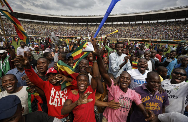 <p>Supporters dance and run on the field after Zimbabwe's President Emmerson Mnangagwa was sworn in at the presidential inauguration ceremony in the capital Harare, Zimbabwe Friday, Nov. 24, 2017. (Photo: Ben Curtis/AP) </p>