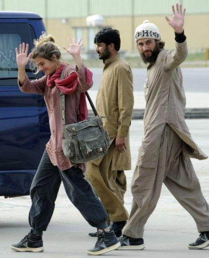 Swiss couple Daniela Widmer (L) and Olivier David Och (R) wave upon their arrival at the Qasim base in Rawalpindi. Switzerland's foreign minister said the couple escaped