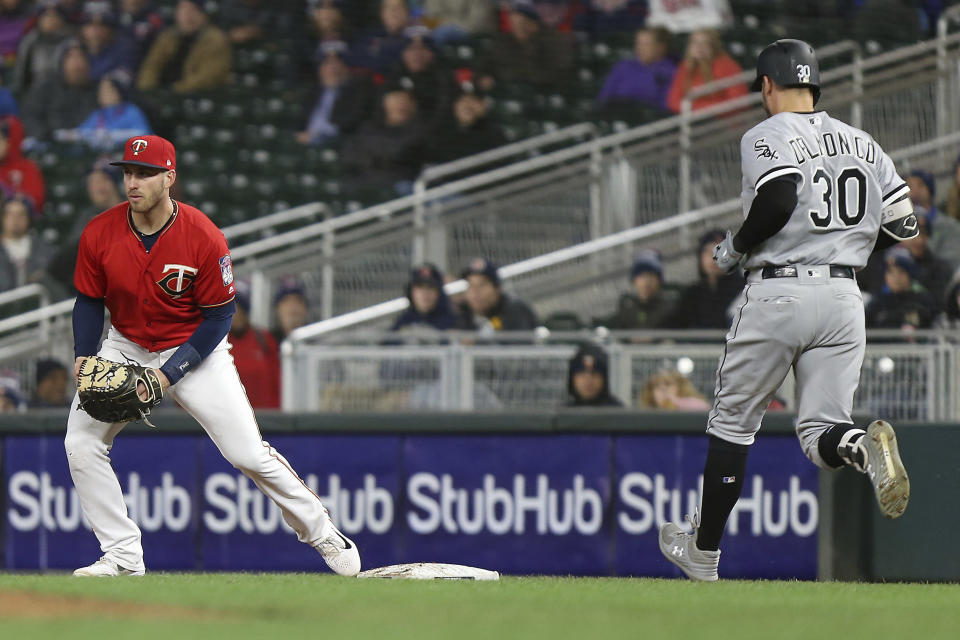 Minnesota Twins' Mitch Garver touches first base to get out Chicago White Sox's Nicky Delmonico during the second game of a baseball doubleheader Friday, Sept. 28, 2018, in Minneapolis. Minnesota won 12-4. (AP Photo/Stacy Bengs)