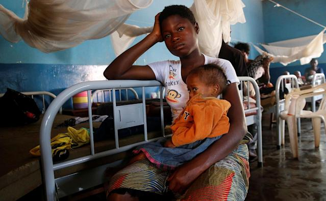 <p>An internally displaced Congolese woman holds her severely acute malnourished child as they wait to receive medical attention at the Presbyterian hospital in Dibindi zone of Mbuji Mayi in Kasai Oriental Province in the Democratic Republic of Congo, March 16, 2018. (Photo: Thomas Mukoya/Reuters) </p>