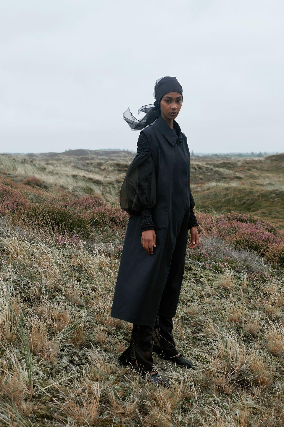 "<p>Cecilie Bahnsen is a sort of intellectual romantic, a designer who leans into an ethereal beauty while imbuing it with something steady and enduring. For this collection, the Copenhagen-based designer had ""a woman on a journey across a landscape"" in mind, and was inspired by Hashimoto Shoko's '70s black-and-white portraits of Goze musicians, James Turrell's immersive light installations, and a P.S. Krøyer painting of a summer night by the sea in Denmark. These weren't just esoteric ideas: The Turrell colors showed up in bright pink and green pieces. But the collection was mostly black and white, which calls to mind the black outfits worn by the blind Japanese women musicians in the photographs and the dreamy white gowns of two women walking on the beach in Krøyer's painting. The looks were all a bit dreamy, like they might float off if the breeze hit just right. —<em>Kerry Pieri</em><em><br></em></p>"