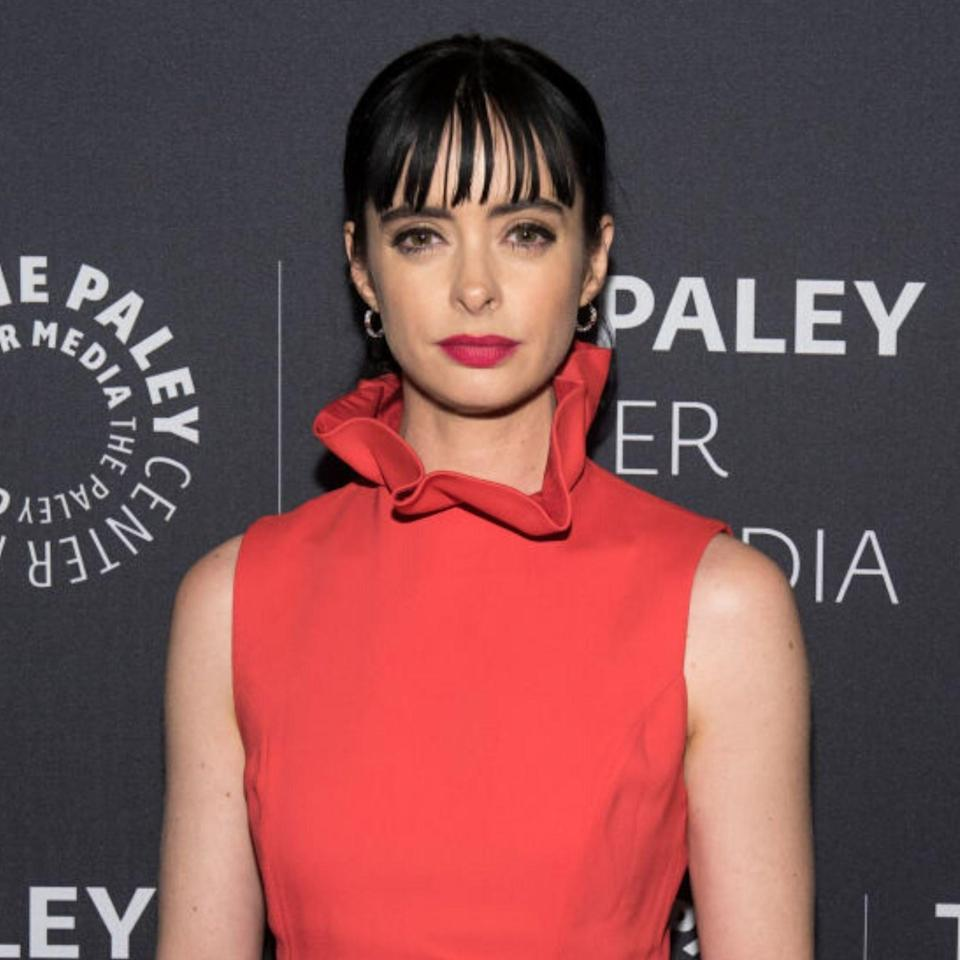 """Bangs don't have to be full and blunt to be on-trend. Krysten Ritter proves piece-y bangs that sit above your eyebrows are just as pretty. In fact, they might just be easier to wear as the openness tones down the intensity and brings all attention to the eyes. If you want to try the trend for 2020 but aren't ready to fully commit, a <a href=""""https://www.allure.com/story/charlize-theron-faux-bangs-adir-abergel?mbid=synd_yahoo_rss"""" rel=""""nofollow noopener"""" target=""""_blank"""" data-ylk=""""slk:hair piece"""" class=""""link rapid-noclick-resp"""">hair piece</a> is a great option to start. Your stylist can even help you trim it to the right fringe length."""