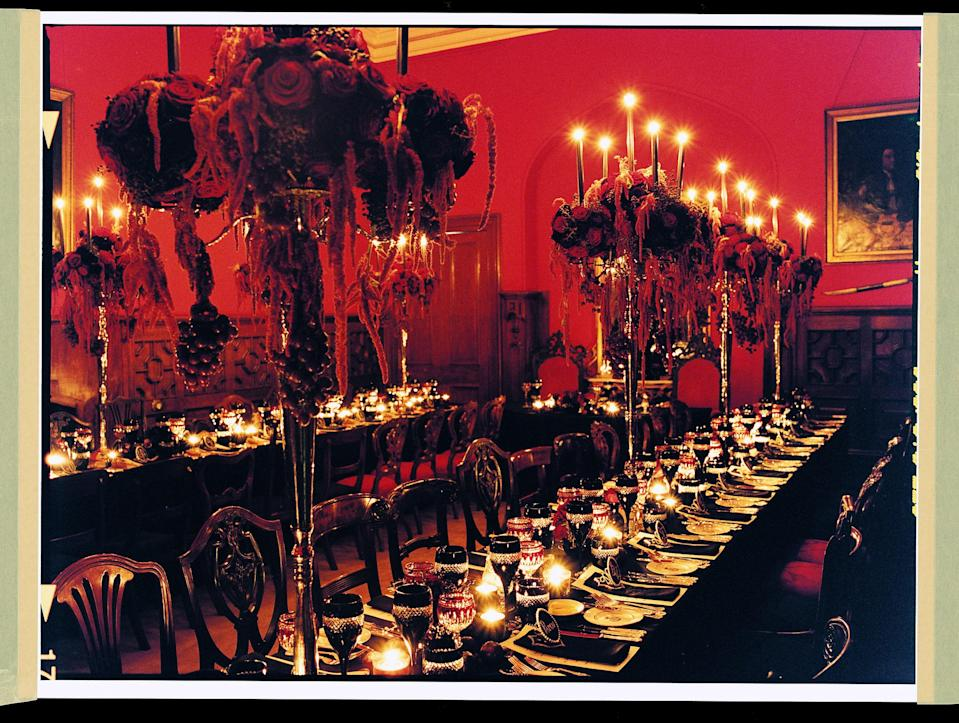 """<h1 class=""""title"""">The wedding-banquet table is set with Waterford crystal, Wedgwood china, and centerpieces designed by Hayley Newstead, executed by Absolute Flowers.</h1> <div class=""""caption""""> The wedding-banquet table is set with Waterford crystal, Wedgwood china, and centerpieces designed by Hayley Newstead, executed by Absolute Flowers. </div> <cite class=""""credit"""">Photographed by Robert Fairer, <em>Vogue,</em> March 2006</cite>"""