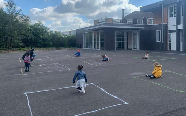 Children are seen social distancing within a school in France - @lioneltop/Twitter