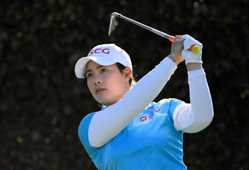 FILE - In this April 20, 2018, file photo, Moriya Jutanugarn, of Thailand, watches her shot from the seventh tee during the second round of the LPGA Tour's HUGEL-JTBC LA Open golf tournament at Wilshire Country Club in Los Angeles. Ariya and Moriya Jutanugarn play golf and live life differently. The sisters from Thailand have won two of the last four LPGA tournaments and are attempting at the Volvik Championship to become the first two-time winner this year. (AP Photo/Mark J. Terrill, File)