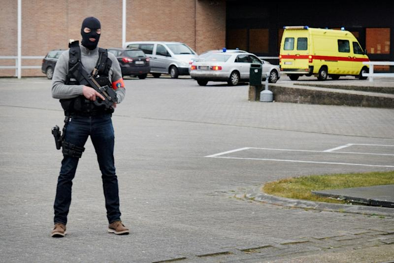 The ambulance believed to be transporting top Paris attacks suspect Salah Abdeslam arrives at the Bruges prison, on March 19, 2016