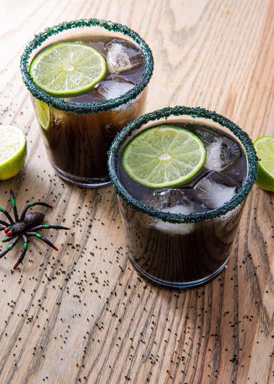 "<p>Pour some black magic this Halloween!</p><p>Get the recipe from <a href=""https://www.delish.com/cooking/recipe-ideas/recipes/a55953/black-magic-margaritas-recipe/"" rel=""nofollow noopener"" target=""_blank"" data-ylk=""slk:Delish"" class=""link rapid-noclick-resp"">Delish</a>.</p>"