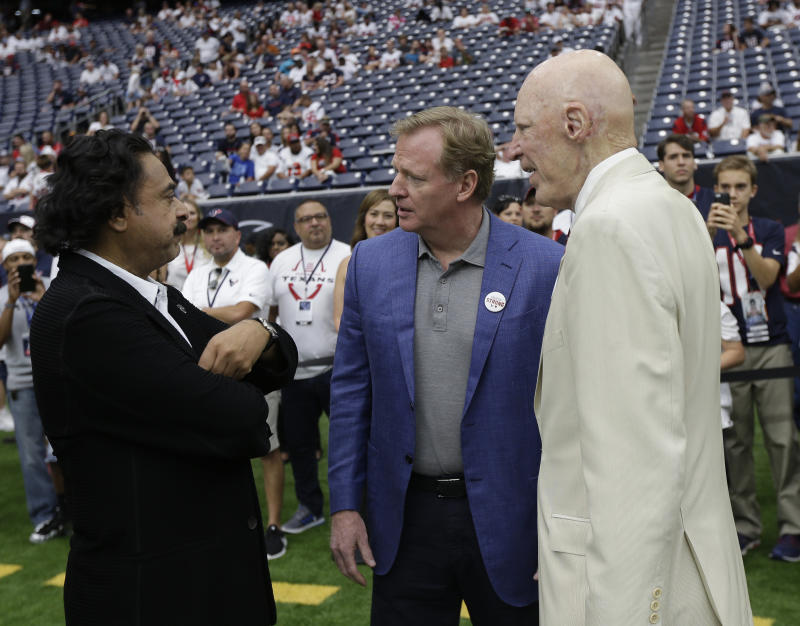 The Jags' Shad Khan (left), talking with NFL commissioner Roger Goodell (middle) and Texans owner Bob McNair, is entering his sixth full season of owning the team. (AP)