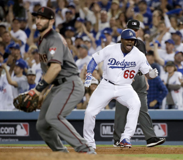 """<a class=""""link rapid-noclick-resp"""" href=""""/mlb/teams/lad/"""" data-ylk=""""slk:Los Angeles Dodgers"""">Los Angeles Dodgers</a>' <a class=""""link rapid-noclick-resp"""" href=""""/mlb/players/9341/"""" data-ylk=""""slk:Yasiel Puig"""">Yasiel Puig</a> celebrates after a single against the <a class=""""link rapid-noclick-resp"""" href=""""/mlb/teams/ari/"""" data-ylk=""""slk:Arizona Diamondbacks"""">Arizona Diamondbacks</a> during the fourth inning of Game 2 of baseball's National League Division Series in Los Angeles, Saturday, Oct. 7, 2017. (AP)"""