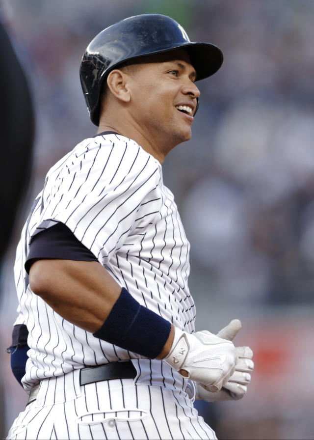 New York Yankees' Alex Rodriguez smiles as he rounds first base after hitting a home run for his 3,000th career hit, during the first inning of a baseball game against the Detroit Tigers on Friday, June 19, 2015, in New York. (AP Photo/Frank Franklin II)