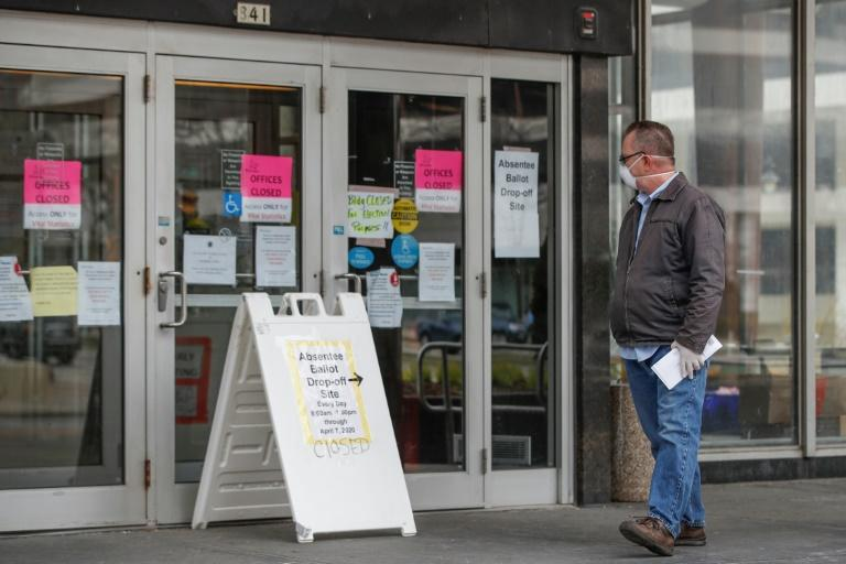 A man seeking to cast his ballot leaves the Frank P. Zeidler Municipal Building in Milwaukee after discovering that the drop-off site has already closed