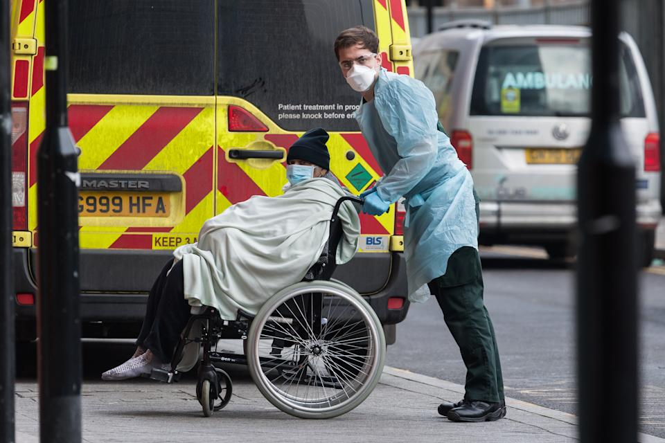 Paramedic transports a patient  from the ambulance to the emergency department at the the Royal London Hospital, on 15 January, 2021 in London, England. Hospitals across the country are dealing with an ongoing rise in Covid-19 cases, providing care to more than 35,000 people, which is around 50% more than at the peak of the virus in spring, with fears that hospitals in London may be overwhelmed within two weeks unless the current infection rate falls. (Photo by WIktor Szymanowicz/NurPhoto via Getty Images)