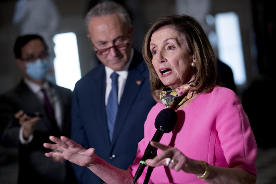 House Speaker Nancy Pelosi of Calif., center, accompanied by Senate Minority Leader Sen. Chuck Schumer of N.Y., left, speak to reporters following a meeting with Treasury Secretary Steven Mnuchin and White House Chief of Staff Mark Meadows as they continue to negotiate a coronavirus relief package on Capitol Hill in Washington, Friday, Aug. 7, 2020. (AP Photo/Andrew Harnik)