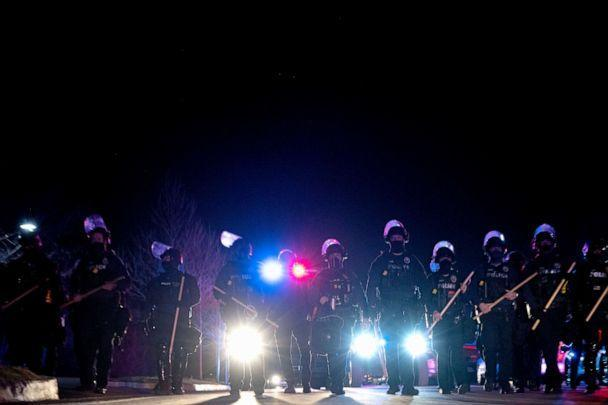 PHOTO: Louisville Metro Police Department officers march toward a group of protesters after the Breonna Taylor memorial events, March 13, 2021, in Louisville, Kentucky. (Jon Cherry/Getty Images)