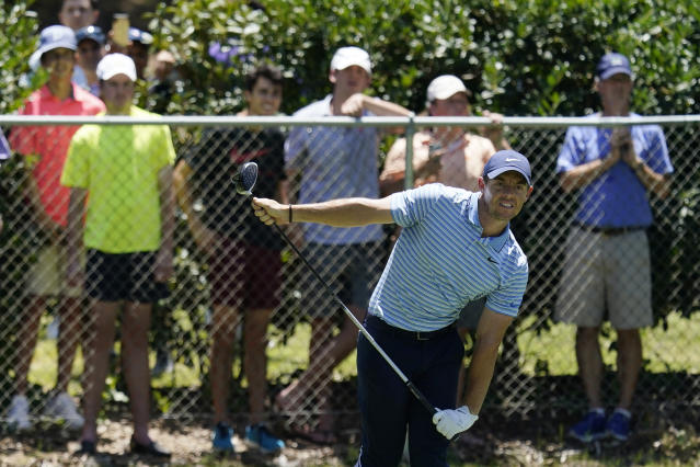 Rory McIlroy, of Northern Ireland, watches his tee shot on the second hole during the third round of the Charles Schwab Challenge golf tournament at the Colonial Country Club in Fort Worth, Texas, Saturday, June 13, 2020. (AP Photo/David J. Phillip)