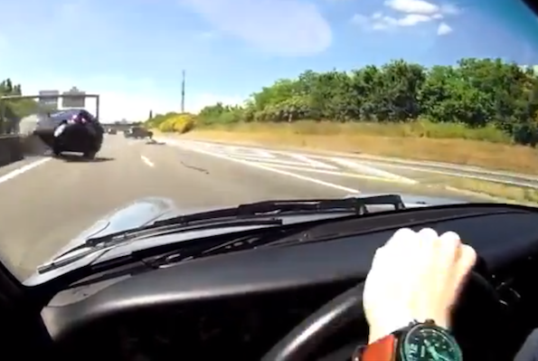 Porsche driver shows off car control skills to avoid collision