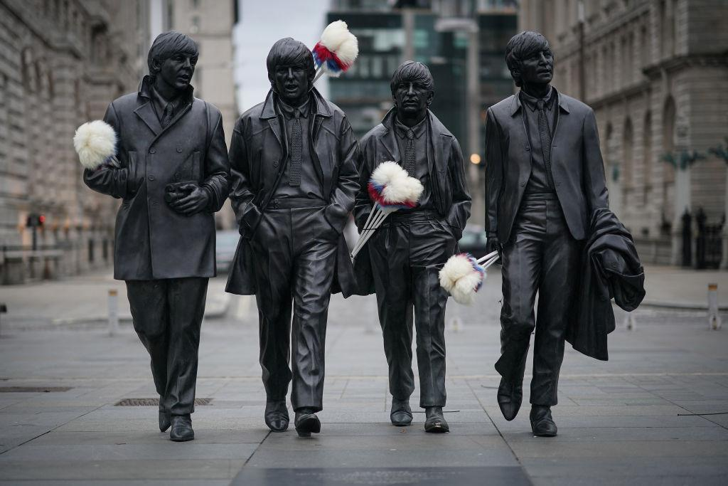 <p>The Beatles Statue at Liverpool's Pier Head is adorned with tickling sticks in tribute to the late comedian Ken Dodd in Liverpool, England. The City of Liverpool has placed tickling sticks on monuments and attractions across the city in tribute to British comedy legend Ken Dodd, whose funeral took place this week at the Anglican Cathedral. (Christopher Furlong/Getty Images) </p>