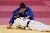 Funa Tonaki, top, of Japan, reacts after losing to Distria Krasniqi, of Kosovo, in their women's 48-kg judo gold medal match at the 2020 Summer Olympics, Saturday, July 24, 2021, in Tokyo. (AP Photo/Jae C. Hong)