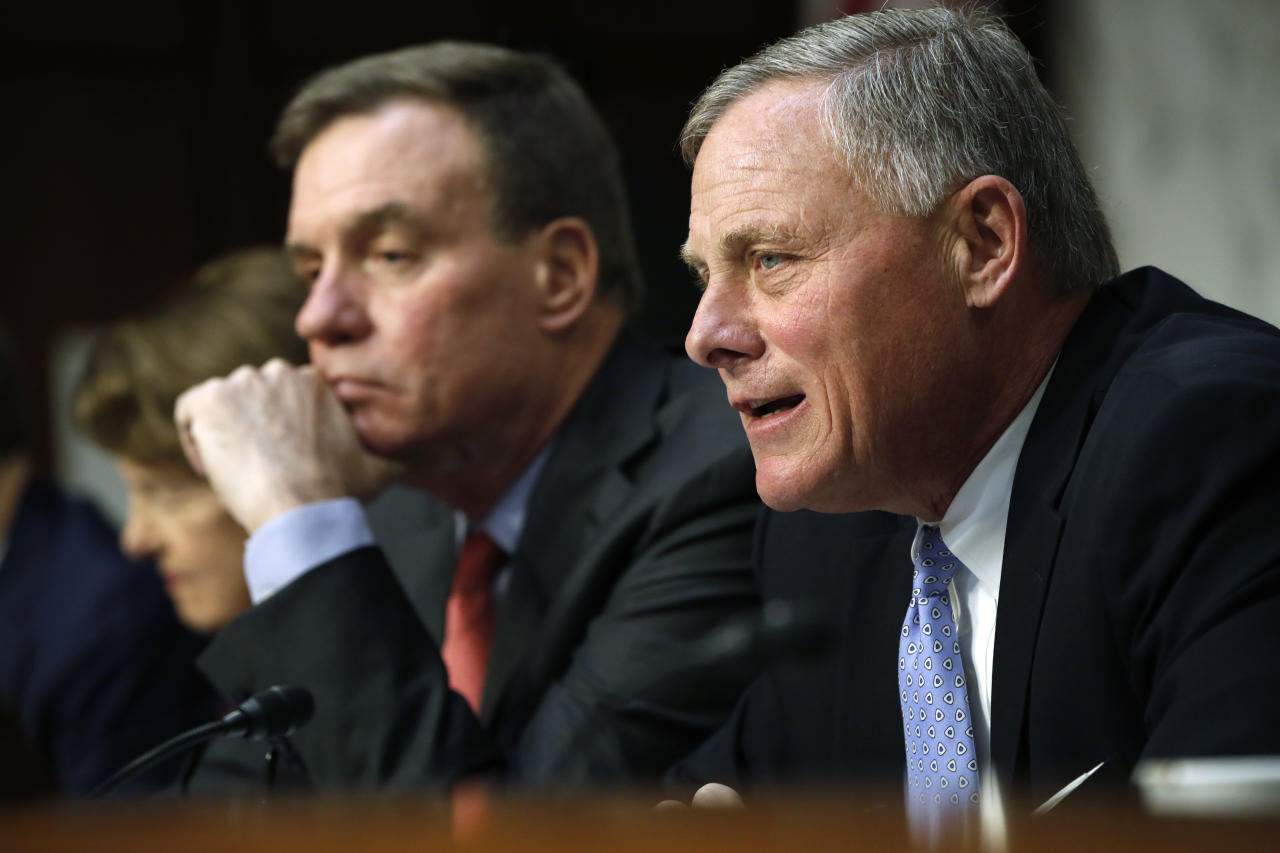 FILE - In this Nov. 1, 2017, file photo, Senate Intelligence Committee chairman Sen. Richard Burr, R-N.C., right, speaks next to Vice Chairman Sen. Mark Warner, D-Va., during a Senate Intelligence Committee hearing on Russian election activity and technology on Capitol Hill in Washington. As Congress returns from its Thanksgiving break, some Republicans would like to wrap up investigations into Russian meddling in the 2016 election that have dragged on for most of the year. But with new details in the probe emerging on an almost daily basis, that timeline seems unlikely. (AP Photo/Jacquelyn Martin, File)
