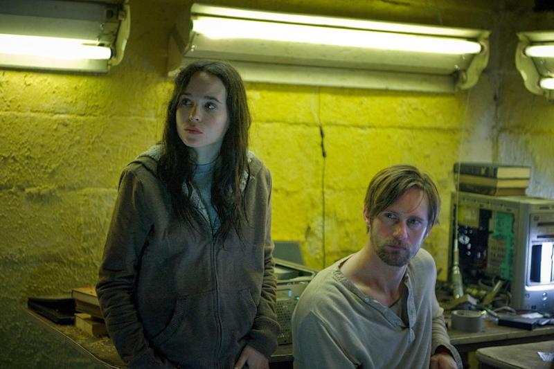 """This film publicity image released by Fox Searchlight Pictures shows Ellen Page, left, and Alexander Skarsgard in a scene from """"The East."""" (AP Photo/Fox Searchlight Pictures, Myles Aronowitz)"""