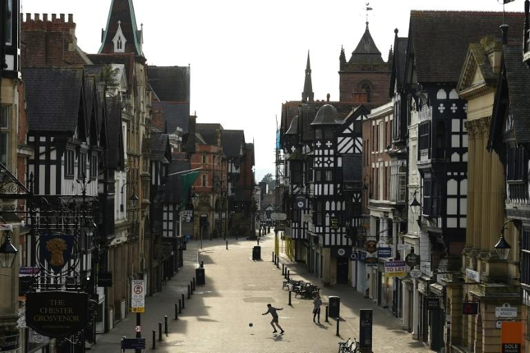 While some people flouted the lockdown to enjoy the sunny weather, the streets of some towns, such as here in Chester, remained virtually empty