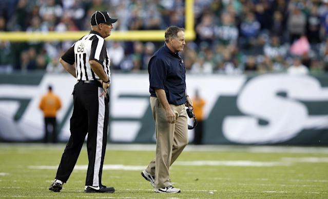 CORRECTS KICKER'S LAST NAME TO FOLK, NOT FOLES - In this photo taken Sunday, Oct. 20, 2013, New England Patriots coach Bill Belichick walks away from line judge Tom Stephan after the Patriots were called for an unsportsmanlike penalty after New York Jets kicker Nick Folk missed a field goal during overtime of an NFL football game in East Rutherford, N.J. The Patriots' Chris Jones was called for the penalty after pushing a teammate forward to try to block the kick, a new NFL rule. The Jets won the game 30-27 in overtime. (AP Photo/Kathy Willens)
