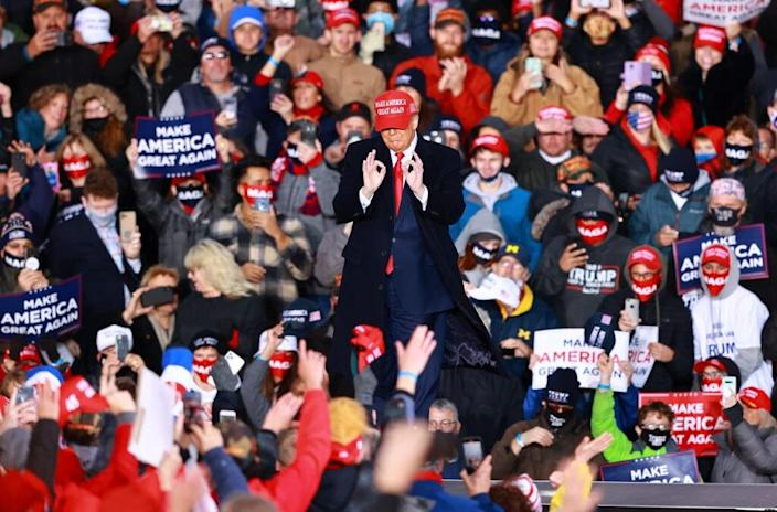 U.S. President Donald Trump gestures during a campaign rally on October 17, 2020 in Muskegon, Michigan. (Photo by Rey Del Rio/Getty Images)