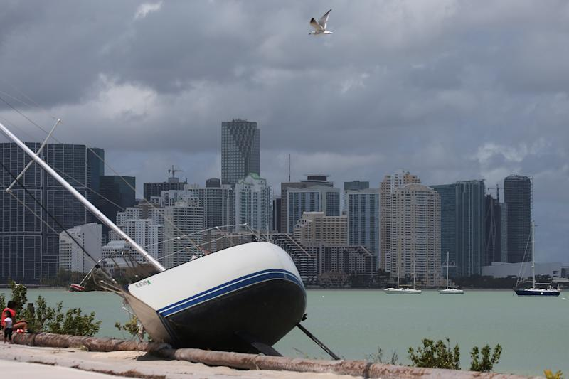 The Miami skyline is seen above a boat that went ashore after the passing of Hurricane Irma. (Carlo Allegri / Reuters)