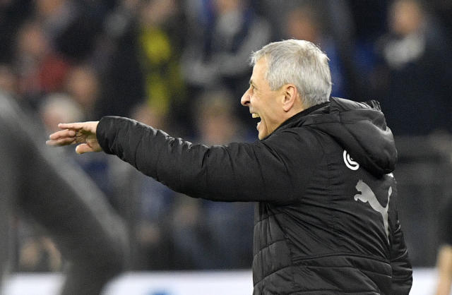 Dortmund coach Lucien Favre reacts during the German Bundesliga soccer match between FC Schalke 04 and Borussia Dortmund at the Arena in Gelsenkirchen, Germany, Saturday, Dec. 8, 2018. (AP Photo/Martin Meissner)