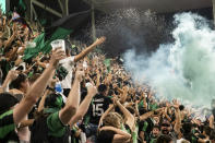 Austin FC fans celebrate the team's first goal, scored by Moussa Djitté, by throwing beer into the air during the second half of an MLS soccer match against the LA Galaxy, Sunday, Sept. 26, 2021, in Austin, Texas. Austin FC won 2-0. (AP Photo/Michael Thomas)