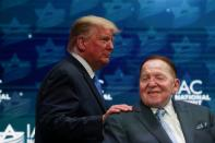 FILE PHOTO: U.S. President Trump greets Sheldon Adelson while taking the stage at the Israeli American Council National Summit in Hollywood, Florida