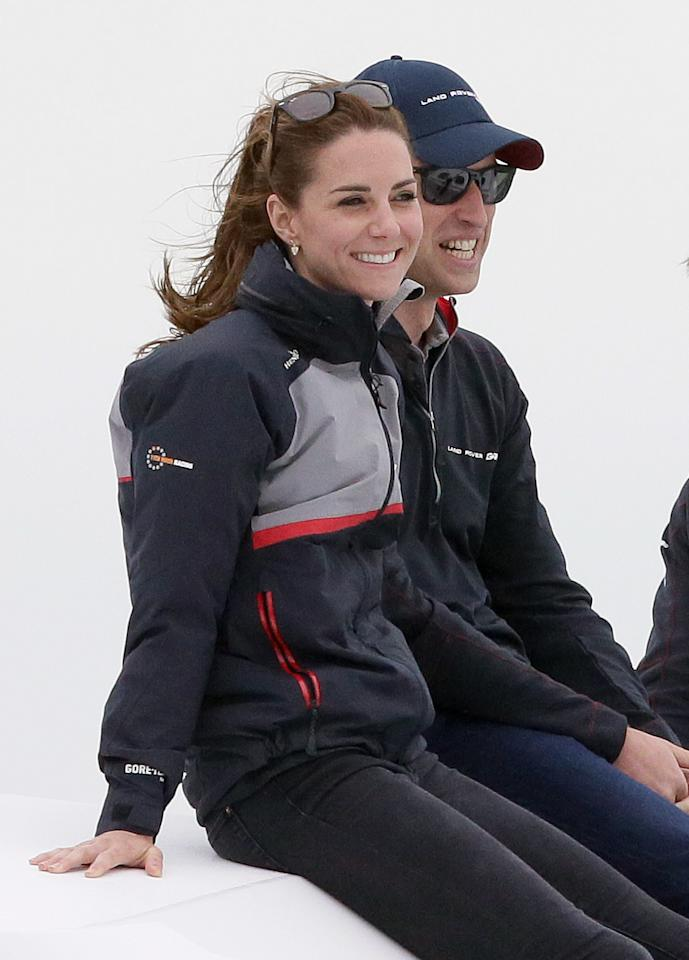 Britain's Kate, Duchess of Cambridge and Prince William watch the America's Cup World Series Race from a boat on the Solent, in Portsmouth, England, Sunday, July 24, 2016. The royal couple visited the home of the British competitors for the America's Cup before observing the ongoing competition. (AP Photo/Tim Ireland, Pool)