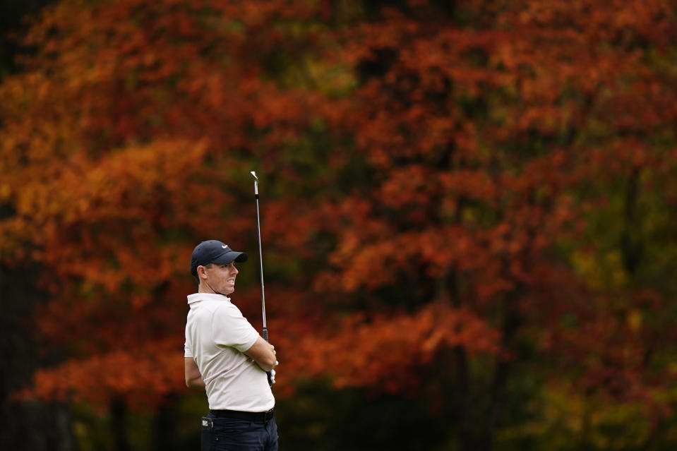 Rory McIlroy, of Northern Ireland, watches his shot on the 11th hole during a practice round for the Masters golf tournament Tuesday, Nov. 10, 2020, in Augusta, Ga. (AP Photo/Matt Slocum)