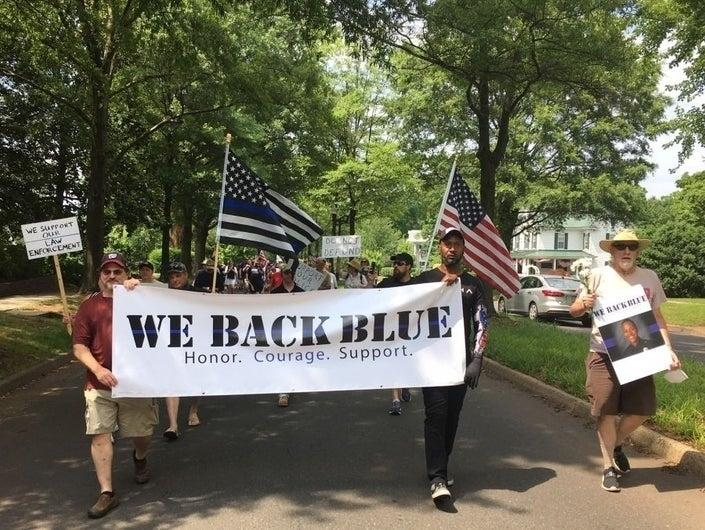 Hundreds of people marched in the streets of Manassas Saturday afternoon to show their support for law enforcement officers.