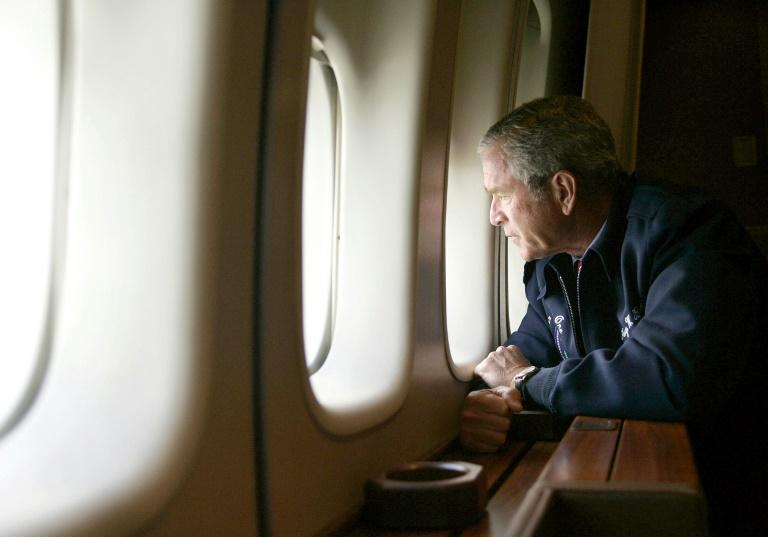 "US President George W. Bush looks out the window of Air Force One in 2005 as he flies over hurricane-ravaged New Orleans -- one commentator has suggested Trump is having his ""Katrina moment"""