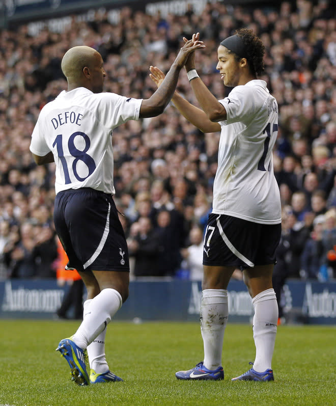 """Tottenham Hotspur's English striker Jermain Defoe celebrates scoring his goal with  Tottenham Hotspur's Mexican player Giovani dos Santos (R) during the English FA Cup 3rd Round football match between Tottenham Hotspur and Cheltenham Town at White Hart Lane in north London, England on January 7, 2012.   RESTRICTED TO EDITORIAL USE. No use with unauthorized audio, video, data, fixture lists, club/league logos or """"live"""" services. Online in-match use limited to 45 images, no video emulation. No use in betting, games or single club/league/player publications (Photo by Ian Kington/AFP/Getty Images)"""